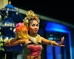 Balinese dancer (jeremyhughes) Tags: bali woman art night indonesia costume nikon pretty dof arty dancing expression traditional arts makeup dancer entertainment nighttime lipstick nikkor headdress jimbaran 85mmf14d jimbaranbay balinesedancer balinesedancing d700