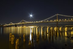 Bay Bridge and the Moon... (Richard Thelen) Tags: ocean sanfrancisco california trip travel bridge vacation sky usa moon color art water digital canon landscape geotagged photography eos oakland coast photo pacific d wide sigma wideangle pacificocean bikini photograph baybridge 1020 lunar themoon cokin 77mm sigma1020 nohdr