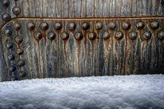 Cold Steel (rickhanger) Tags: railroad winter snow train rust rivets rusty railcar tanker