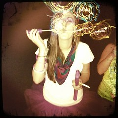 Bubbles. (WillowRejective) Tags: birthday party fun sticks colorful neon glow drink cigarette drinking bubbles blowing birthdayparty blow alcohol tutu glowsticks