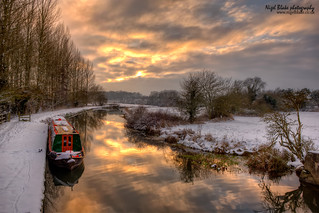 Narrowboat on the River Stort at dusk.