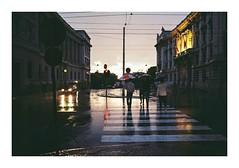 Fedele #1 (Lalangue.) Tags: analog nikonfm kodacolor ancona rain rainingday ombrelli sunset viale desolate