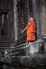 Buddhist monk, Angkor Wat (www.bartbrouwerphotography.com) Tags: monk buddhism buddhistmonk angkorwat cambodia siemreap travel orange hiding children culture temple asia religion fujix100s