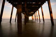 Sunset Pier (Ben Duursma) Tags: pier sunset wooden wood unused orange sunlight sun red blur neutral gradient filter 10 stop long exposure pakefield norfolk england landscape water sea youngphotographers
