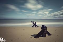 Mundesley 8 (davemoly17) Tags: davidmolyneuxphotography sea seaside beach beachhuts coast sand groynes waves water mundesley norfolk lifeboat sunny canon eos 1100d sigma wideangle