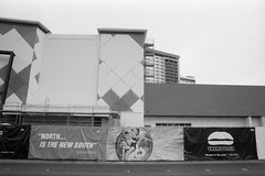 North Is the New South (Colton Davie) Tags: city bw 2014 canoneoselan7 film march lasvegas street advertisement roadtrip ilforddelta100 nevada sign 35mm iso100 xtol