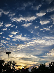 parking lot sunset (jojoannabanana) Tags: 3662016 canonpowershot clouds cloudy dramatic dreamy light shadows silhouette sunlight sunset s100 trees