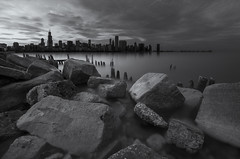 where i found you (momozart) Tags: chicago chitown chicity architecture architectural city cityscape windycity urban blackandwhite noiretblanc moody lake sea ocean water cloudy clouds buildings skyscraper skyline sky rocky rocks longexposure beach beachy fineart monochrome