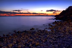 Pebbly beach in the twilight hour (n.pantazis) Tags: longexposure light sea sky beach night clouds dark evening coast twilight pentax cloudy dusk dramatic shore saronicgulf vouliagmeni kavouri 45sec saronicos pentaxk30