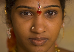 Close Up Of A Young Indian Woman With Traditional Painting On Her Forehead And A Nose Piercing, Madurai, India (Eric Lafforgue) Tags: travel portrait people woman india colour vertical closeup day indoors indie inside earrings tradition hindu indi madurai indien hind tamilnadu indi oneperson bindi inde hodu nosepiercing indland  hindistan indija   ndia hindustan onewomanonly lookingatcamera indianpeople  waistup  traveldestination   oneyoungwoman hindia  bhrat  oneadult indhiya bhratavarsha bhratadesha bharatadeshamu bhrrowtbaurshow  hndkastan       traditionalpaintingontheface traditionalpaintingontheforehead xa0703323