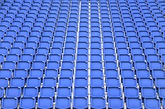Folded blue plastic chairs (Dragos Cosmin- Getty Images Artist) Tags: new uk blue red game color castle texture public sport horizontal modern stairs bench stand football concert chair theater pattern place audience outdoor circus stadium background empty stage seat soccer united bottom group scottish objects nobody row medieval line arena number plastic event blank sit presentation fans seating edinburg spectator section tribune scottland