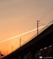 Vapor Stripe (Anubhav Kochhar) Tags: sky mobile canon photography eos pattern metro delhi stripe samsung rail galaxy pollution airline vapour vapor sii anubhav kochhar flickraward flickrtravelaward soloindiantraveller anubhavkochhar airingbyway
