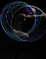 Gynoid (Silvia Pavone) Tags: show female club hoop robot dance movement glow theatre circus contemporary stage character machine clubbing manipulation dancer led entertainment human hooping hulahoop android gynoid hoopdancer robotic coreography jonathangreen isolations hoopdance contemporarycircus glowshow ledhoops glowhoops silviapavone hulahoopact