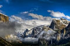 Clearing Sky, Yosemite National Park (BJ Anderson) Tags: california trees winter light sky snow weather rock clouds landscape waterfall yosemite halfdome yosemitenationalpark elcapitan bridalveilfalls yosemitevalley