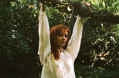 Unroot (maggyvaneijk) Tags: park red portrait white london film nature girl leaves fashion forest 35mm woodland dark hair model arms minolta bokeh branches blouse twig hanging delicate nymph xge