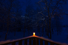 Boundary (Taraji Blue) Tags: europe finland geography arctic arcticcircle balcony blue candle cold december lapland nature night pulju snow torch tree warmth white wild winter
