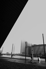 01028895 (paulhome) Tags: white black wet weather manchester quay bbc salford samsungnx16mmf24