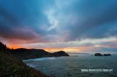 A Fiery Glow Pierces the Gloom: Cape Meares, Oregon (simonrim) Tags: seascape oregon sunrise fire gloom oregoncoast capemeares d90 sunbreakingthrough