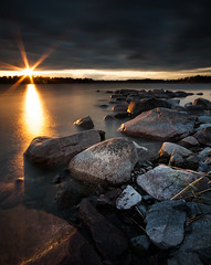 Sun & rocks (- David Olsson -) Tags: longexposure sunset lake reflection nature water clouds landscape nikon rocks sundown cloudy sweden stones tripod sigma le sunburst 1020mm 1020 vnern 2012 darksky dx hammar linedup vrmland ndfilter lakescape skoghall 2exposures d5000 manualblend manuallyblended mrudden nd500 lightcraftworkshop davidolssonapril