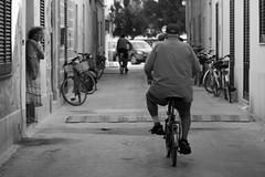 street (usurfaru_) Tags: bike favignana man street black white