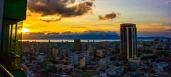 Sunset in Da Nang (free3yourmind) Tags: sunset danang vietnam clouds cloudy river sea city view top above window glass