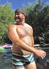 IMG_7889 (danimaniacs) Tags: party swimmingpool shirtless man guy sexy hot bear beard scruff hat cap smile hunk hairy mansolo swimsuit trunks