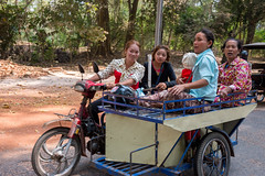 Cambodian Ladies in One Vehicle, Siem Reap, Cambodia (takasphoto.com) Tags: 2870 angkorthom asia cambodge cambodia camboja camboya indochina kingjayavarmanvii kingdomofcambodia lens motoneta motorscooter motorcycle motorroller moto nikkor nikkor2870mmf28d nikkor2870mmf28dedifafszoomlens nikon preahreacheanachakkampuchea professionallens scooter siemreab siemreap skoter skuter skutr southeastasia stepthroughframe transport transportation transporte trasporto travel travelphotography trip verkehr vespa viagem viaje vantai xeom xelai xetho