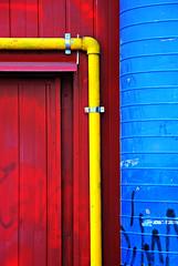 back door beauty (travagliato - brescia, italy) (bloodybee) Tags: door blue red italy yellow graffiti back europe tag tube pipe brescia primarycolors sportshall palazzetto travagliato backdoorbeauty