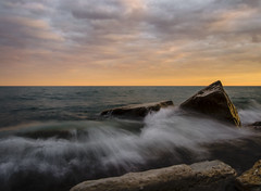 fleeting beauty (olsonj) Tags: lake water clouds sunrise rocks lakemichigan