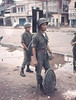 Buddhist riot.  ARVN soldiers with cane riot shields in Saigon.