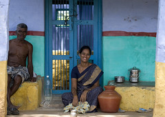 A Woman And A Man Sitting In Front Of A Colorful House, Madurai, India (Eric Lafforgue) Tags: shirtless portrait people india colour horizontal outside outdoors necklace day happiness ring bracelet jar earrings joyful hindu groupofpeople sari madurai tamilnadu cookware bindi bottleofwater nosepiercing oneman colorfulwall smilingface crosslegged seniorman midadultwoman lookingatcamera onewoman indianpeople colorfulhouse twoadults semidressed mixedagerange sittingonthedoorstep mg9949 halffullbottleofwater