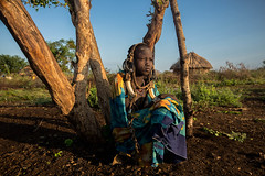 child of the Mursi tribe awakens (anthony pappone photography) Tags: africa travel portrait baby barn digital canon pose children photography photo foto child cows faces image expression retrato african picture culture portraiture afrika enfants fotografia ethiopia ritratto mursi reportage photograher afrique bambino eastafrica mucche phototravel etiopia etnic 非洲 etnico ethiopie etiope etnia アフリカ etnica afryka エチオピア childrentravel etiopija portraitsofchildren mursitribe 아프리카 etiopien etiópia 埃塞俄比亞 africantribe африка etiopi أفريقيا эфиопия 에티오피아 أثيوبيا eos5dmarkii 部族 mursy अफ्रीका childrenbestphotos