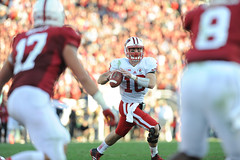 Wisconsin quarterback Curt Phillips (10) looks to pass toward the end of he first half of the 2013 Rose Bowl football game between the University of Wisconsin-Madison Badgers and the Stanford University Cardinal at the Rose Bowl Stadium in Pasadena, Calif