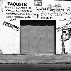 Chauffagiste (Desert Night Sky) Tags: city bw shop wall commerce tunisia tunis tags nb squareformat plumber mur ville faade tunisie urbanphotography plombier formatcarr photourbaine