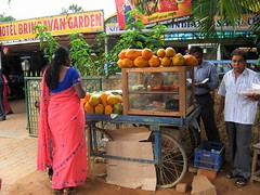 Freshly cut papaya at Brindavan Garden at Chikkaballapur (ShambLady) Tags: life street urban food india fruit asian lunch hotel vegan market eating indian papaya stall streetlife fresh fruta meal vegetarian indians snacks veggie cart karnataka markt eastern saree streetfood sari papaw streetvendor pawpaw vers 2010 popo papaja fingerfood vendors vegetarisch voedsel brindavan papaia tafereel streetwalk  papaye indiaas carica chikka  straatleven betik   chikballapur chikkaballapur  chickballapur balapur   meyvesi kavunaac papaine  chickaballapur