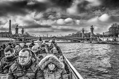 A Parisian River Cruise (Missy Jussy) Tags: paris riverseine river water people boat boattrips historicalcity bridge eiffeltower buildings sky clouds canon cannon600d canon1855 city citylife mono monochrome blackwhite bw europe february cold sunlight