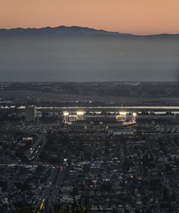 sunset sports (pbo31) Tags: oakland california eastbay alamedacounty july 2016 boury pbo31 nikon d810 over view dark night dusk city urban traffic lightstream motion raiders as coliseum sport arena stadium sunset orange panoramic large stitched color