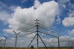 caged clouds (rainbowcave) Tags: clouds fence wire mesh wolken zaun barbwire barbed stacheldraht maschendraht