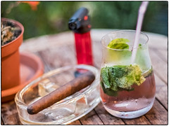 My Rainy Evening In Hamburg Summer Refreshments (/Reality Scanner/) Tags: panasonic lumix gx80 pentaxk smcpentaxa11450mm test hamburg cigar mojito lighter mint glas drink reidsashtray green red longdrink homemade rum rhum outdoor iso3200