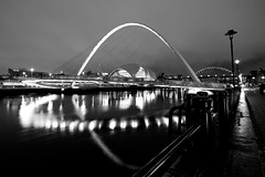 Millennium Bridge (Daisy Swain) Tags: england blackandwhite water architecture night reflections river newcastle lights riverside bridges sage tyne millenniumbridge gateshead tynebridge normanfoster northumberland walkway promenade newcastleupontyne redevelopment sigma1020mm wilkinsoneyre canon60d