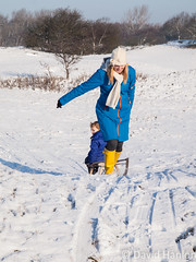 Mother pulls small boy on a sledge (dave hanlon) Tags: family winter holiday snow playing cold kids fun outside outdoors happy vakantie lol dunes dune sneeuw hill familie kinderen mother kind mum together recreation mummy lachen moeder dui