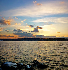 Resilience (Franthropologist) Tags: winter sunset sky panorama sun snow newyork nature water beauty clouds skyscape evening harbor rocks warm waves glow wintersunset dusk stones horizon watertower panoramic longisland seacliff sunburst rays naturalbeauty wintersun greatneck resilience roughwater hempsteadharbor beatingwaves