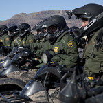 Border Patrol Agents in Line Formation on Motor Bikes