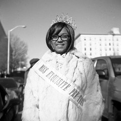 (patrickjoust) Tags: people bw usa white black 120 6x6 tlr blancoynegro film home girl smile analog america lens person us reflex md focus fuji mechanical united north patrick twin maryland baltimore parade celebration crown medium format states manual 80 joust ricoh develop estados superricohflex f35 blancetnoir unidos schwarzundweiss fujifilmneopan100acros autaut martinlutherkingjrparade patrickjoust developedinrodinal missexquisite