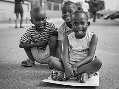 streetriders // mamelodi, south africa (pamela ross) Tags: street bw playing smile kids pen paper children southafrica happy streetphotography games olympus pretoria mamelodi pamelaross epl5