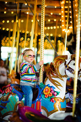 Carousel Confidence (Jon Anderson|Photography) Tags: seattle girl sunglasses photography zoo jon child minolta bokeh f14 sony 85mm carousel full anderson frame fullframe alpha washingtonstate confident woodlandparkzoo confidence seattlewa sonyalpha minolta85mmf14 alpha850