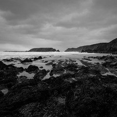 Dark Shores (Ed Spence) Tags: bw white black wales canon island coast rocks sigma shore sands pembrokeshire marloes