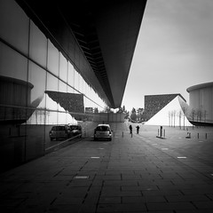 The Mirror Wall (Gilderic Photography) Tags: city people urban bw white black reflection silhouette wall architecture modern canon square eos mirror hall concert europe raw noir pyramid perspective symmetry nb reflet luxembourg mur blanc ville kirchberg lightroom carre 500d 500x500 gilderic
