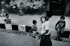 Street children during recreation time (SBH Sahal) Tags: street blackandwhite game children toddler child outdoor funtime poor streetphotography lifestyle innocence recreation dhaka deprived groupofpeople playful bangladesh sandal onthemove shuttlecock sahal outofcontext urbanscene gulshan 1011years preschoolage syedbadrulhussain