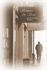 L'ombra del vento (Gareth Priest) Tags: uk light portrait inspiration man art silhouette sign shop sepia wales dark person book nikon experimental mood arcade creative cardiff atmosphere eerie story shade figure mysterious process bookshop tones edit oldfashioned theshadowofthewind d5100